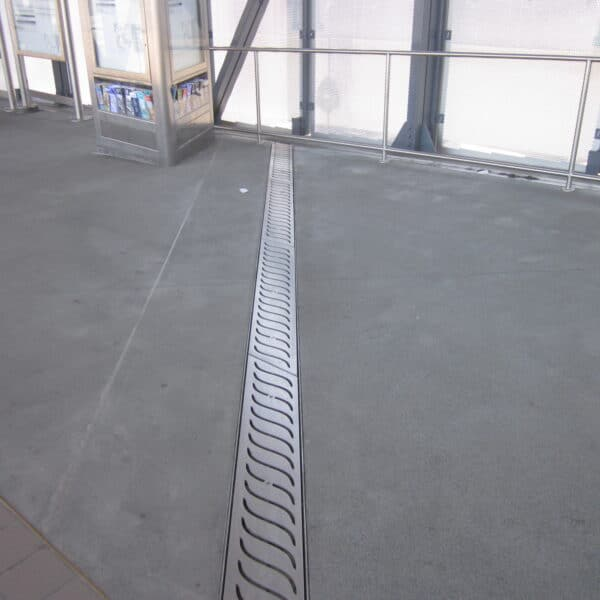 decorative trench drain in an airport walkway