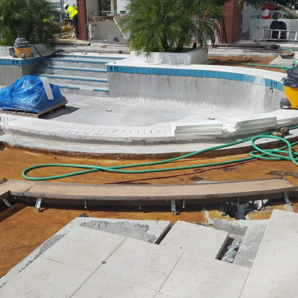combination of curved and straight trench drain at a pool