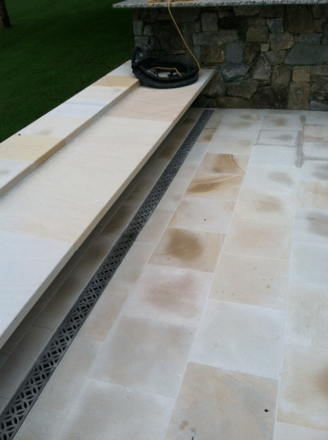 Residential patio trench drain with ornamental aluminum grate