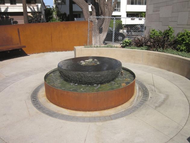 Tight radius trench drain at fountain