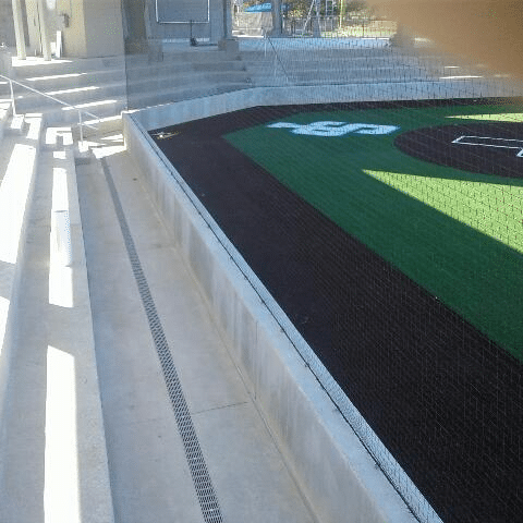 Trench drain at stadium is straight because of long sections.
