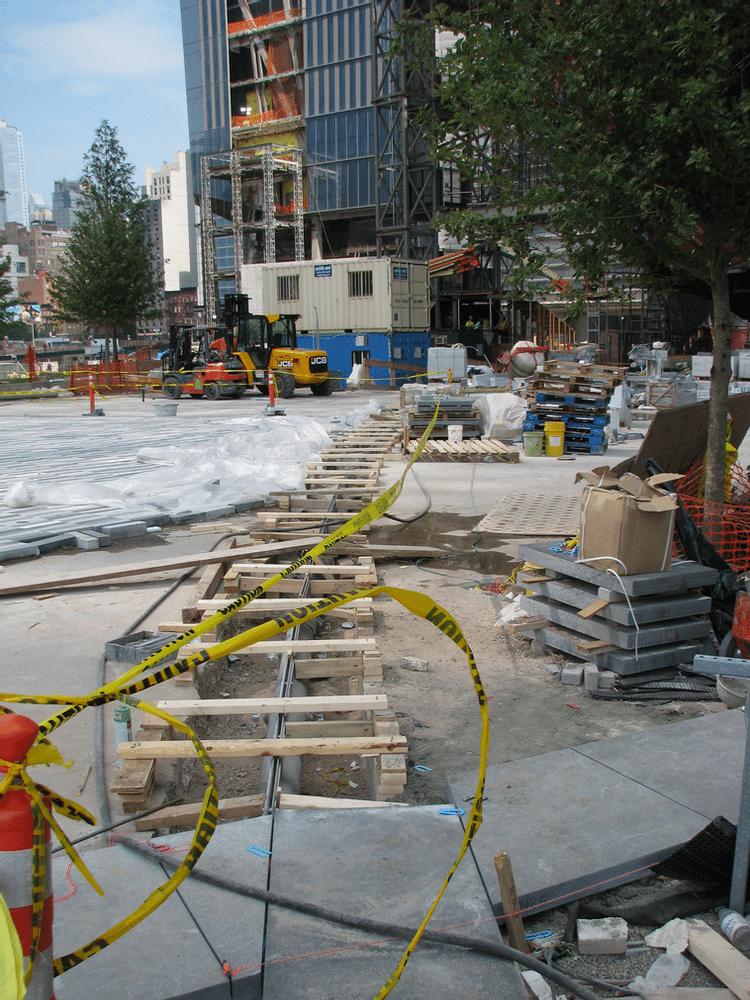 Radius slot drain under construction in park application