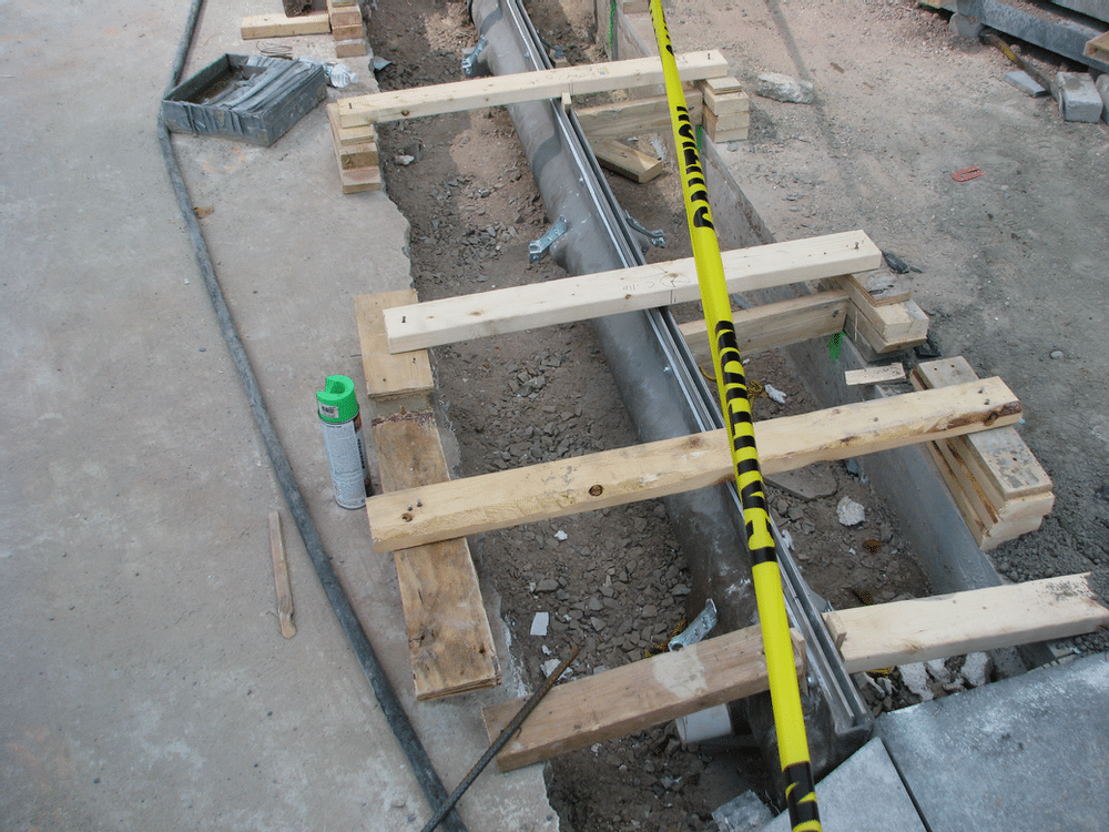 Narrow reveal slot drain practically disappears once paving stone is installed.