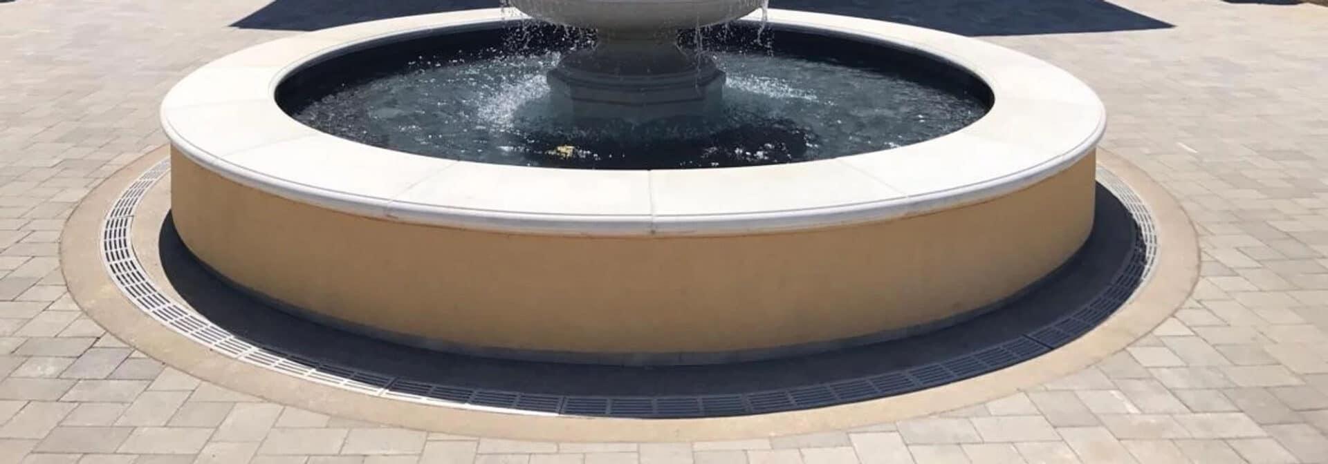 radius trench drain around a water fountain, ada compliant