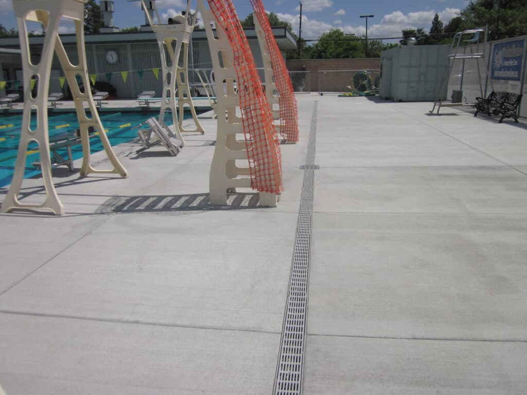 University swimming and diving pool trench drain system