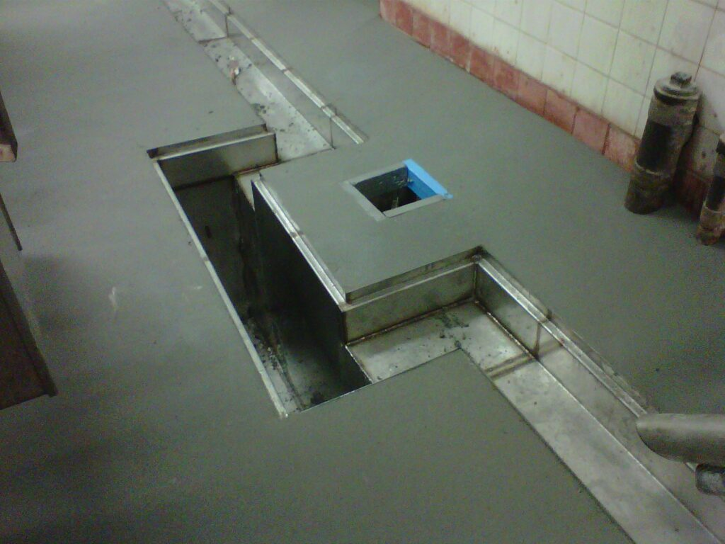 Relining of concrete trench drains