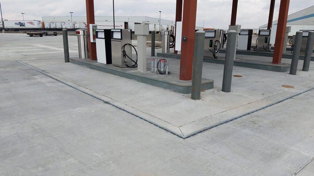 Fueling station slot drain