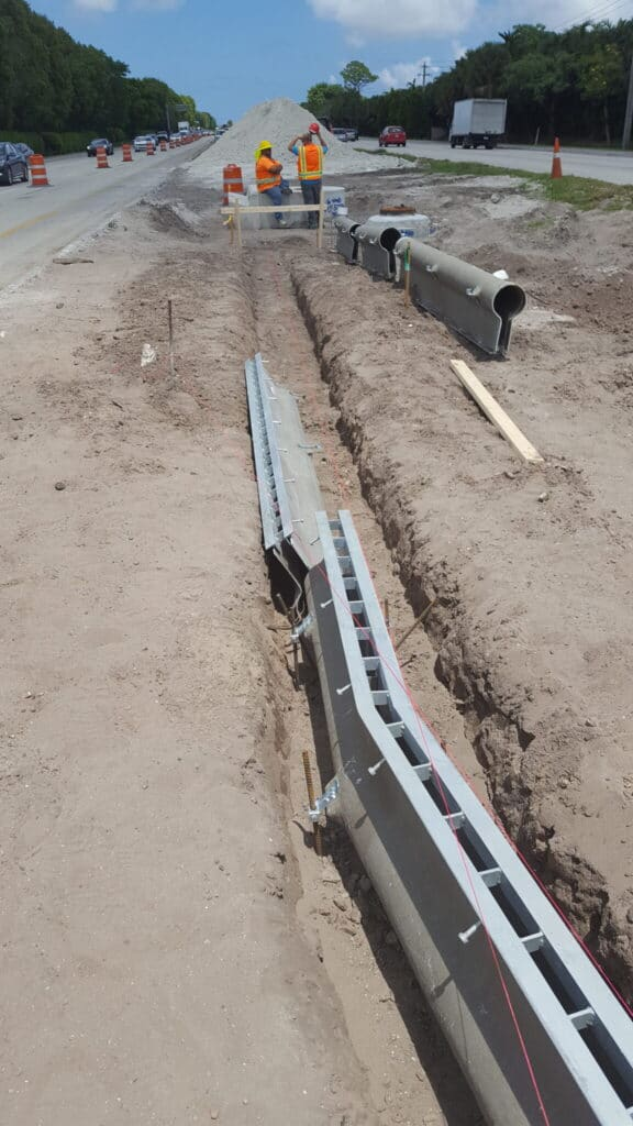 Slot drain system with turns and tees