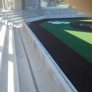 Plastic trench drain grates at sports field