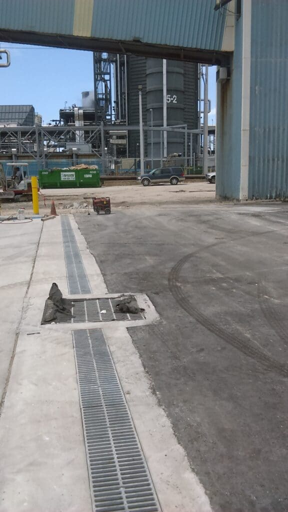 Port loading for trench drains