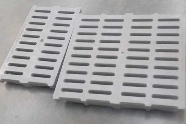 Compression molded fiberglass trench drain grates