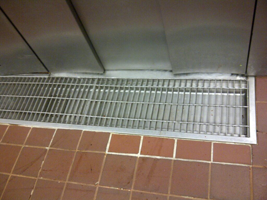 Freezer door trench drain