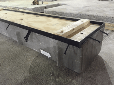 Heavy duty trench drain end frame