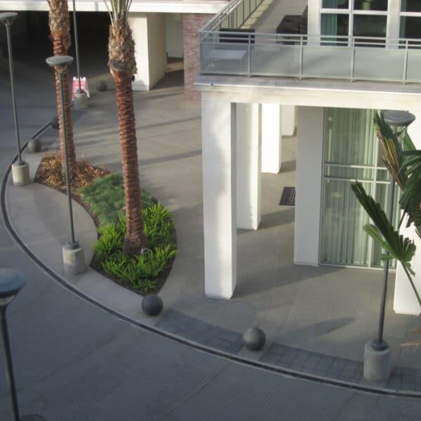 Condominium entrance radius trench drain