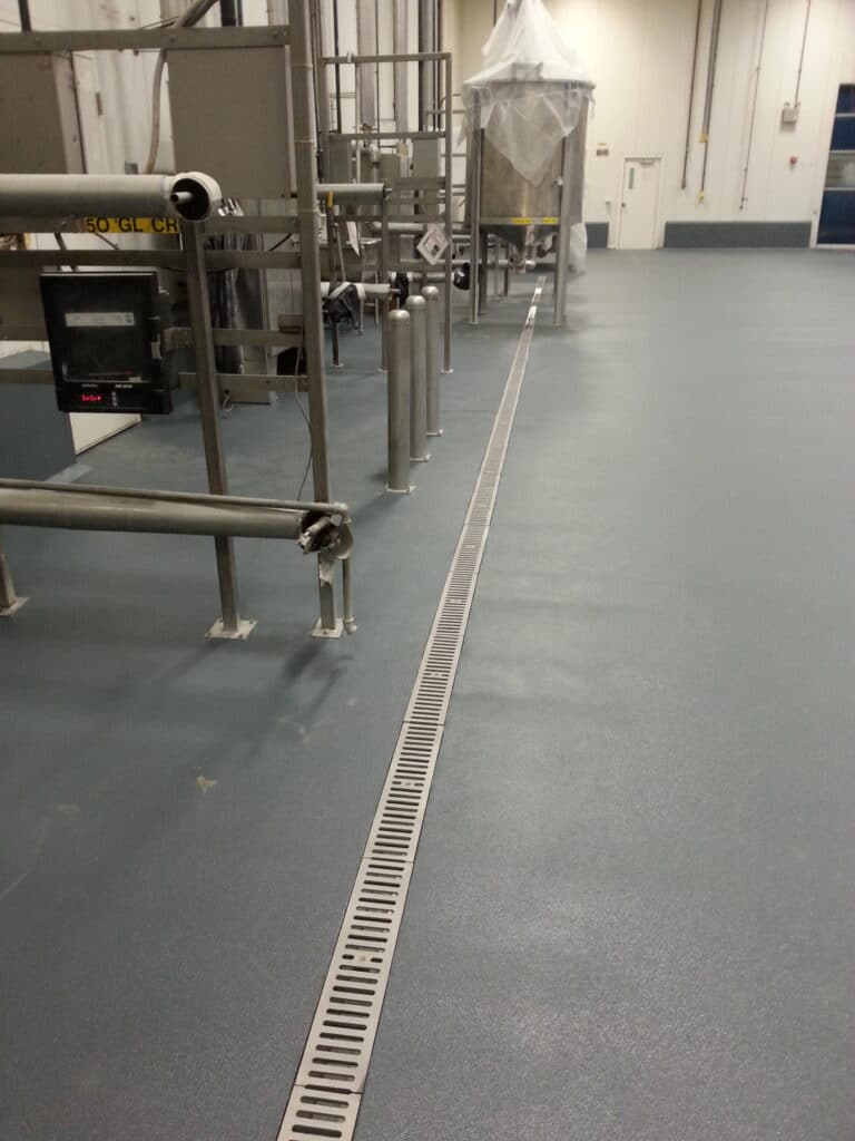 Food blending plant with stainless steel trench drain