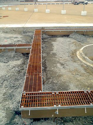 Airport apron trench drain system