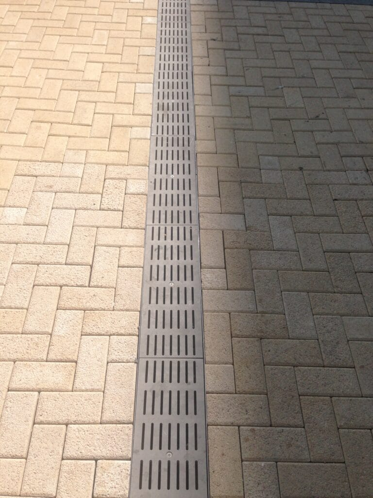 Decorative stainless steel trench drain