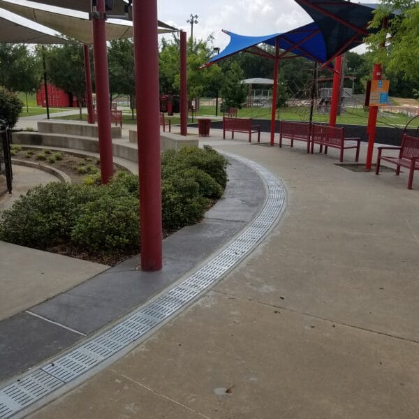 Park with radius trench drain