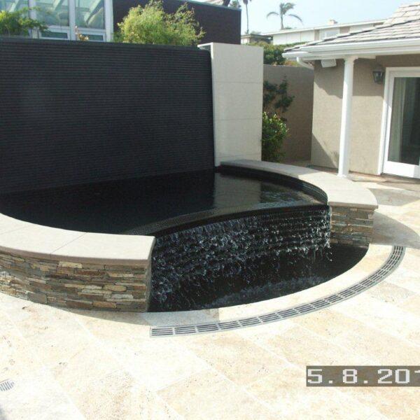 Water feature radius trench drain